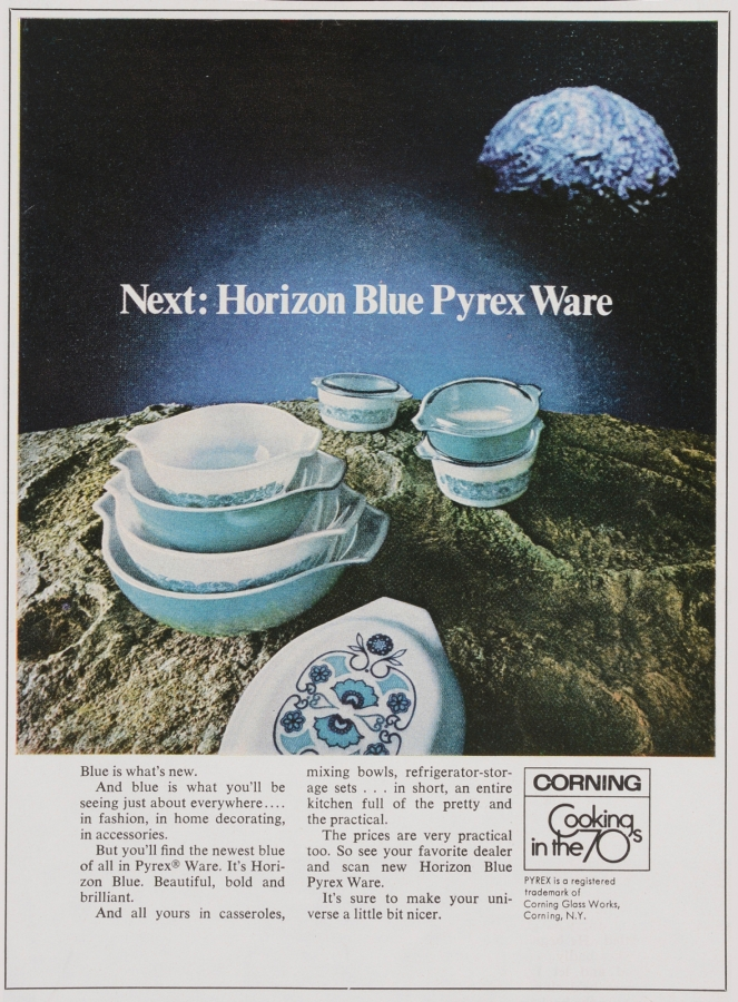 "Advertisement features new Horizon Blue casseroles, mixing bowls, and refrigerator-storage sets in various piles atop a planet or asteroid; illuminated moon, planet, or asteroid appears on upper right. Text is featured below. ""Corning: cooking in the 70s"""